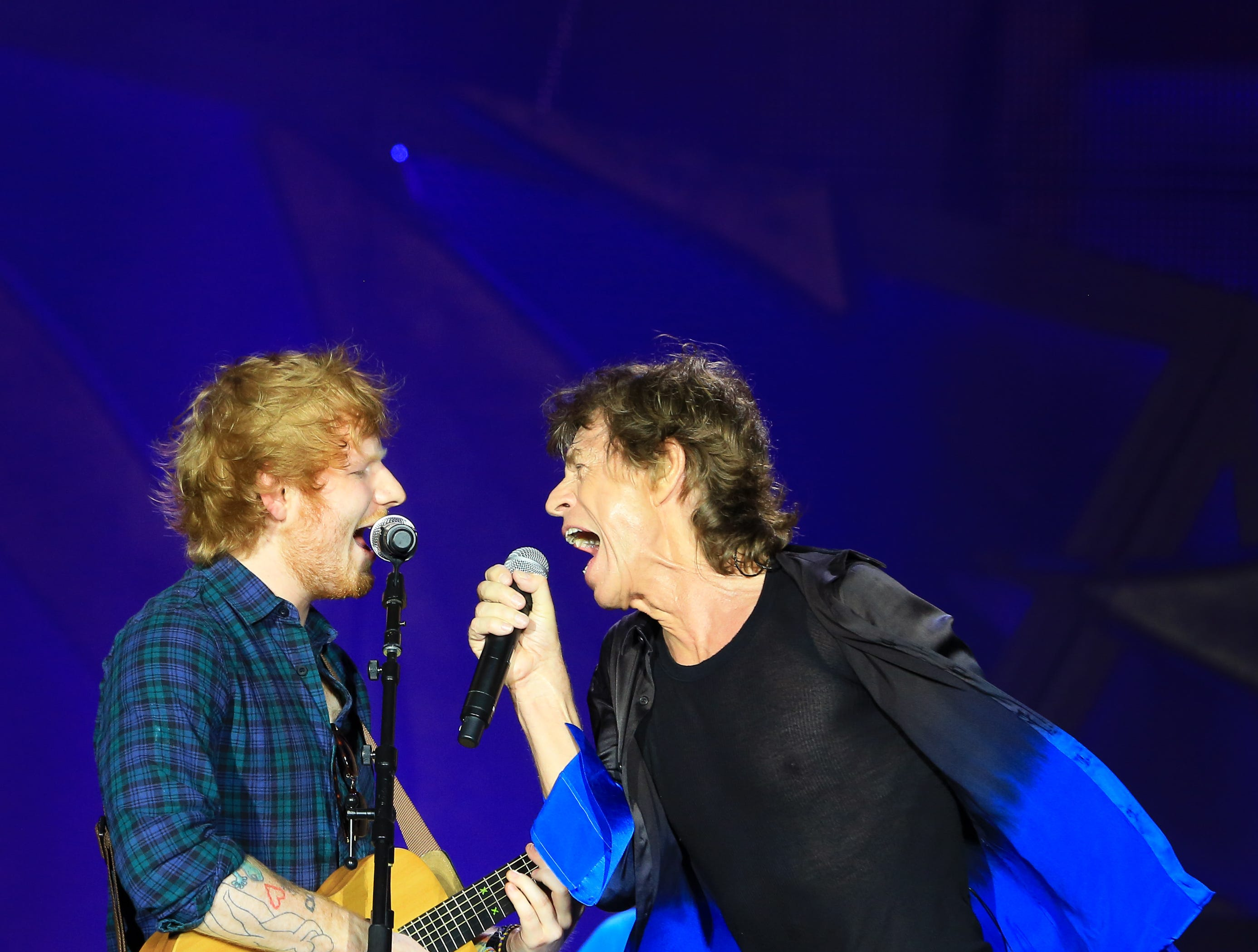 KANSAS CITY, MO - JUNE 27:  Musician Ed Sheeran joins musician Mick Jagger of The Rolling Stones during The Rolling Stones North American 'ZIP CODE' Tour at Arrowhead Stadium on June 27, 2015 in Kansas City, Missouri.  (Photo by Jason Squires/WireImage) ORG XMIT: 561123863 ORIG FILE ID: 478837296
