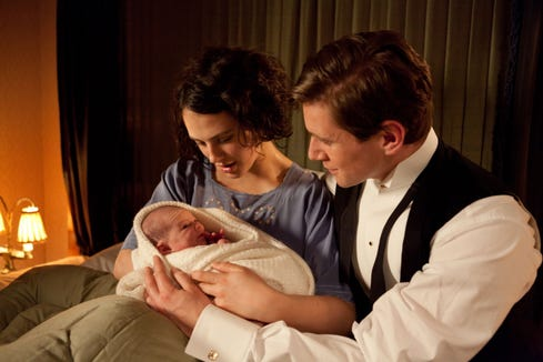 Lady Sybil (Jessica Brown Findlay) and Tom Branson (Allen Leech) in 'Downton Abbey' after the birth of their daughter.