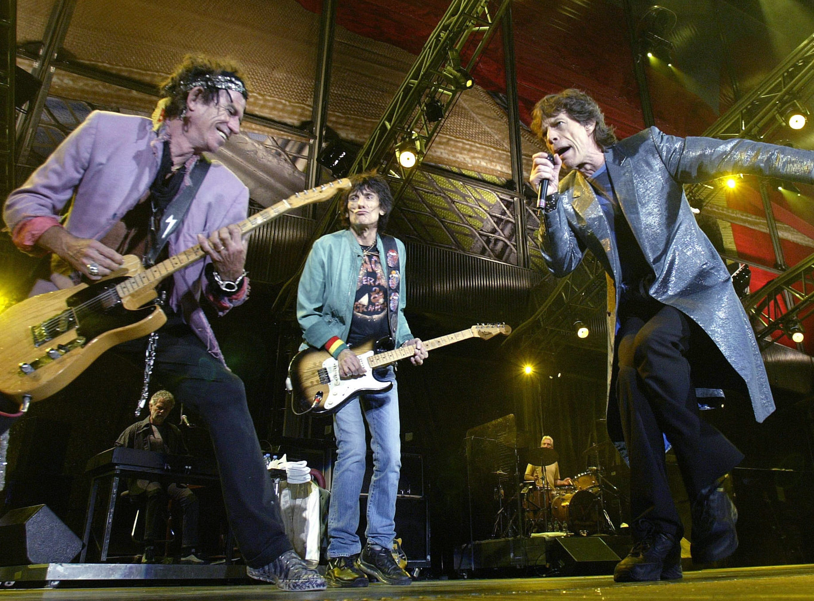 TO GO WITH AFP STORY BY JAMES PHEBY (FILES) A file picture taken in Benidorm, Spain, on September 25, 2003, shows Rolling Stones members lead singer Mick Jagger (R), Ron Wood (C) and Keith Richards (L). Most London shoppers rush by 165 Oxford Street without a second glance -- but it was here 50 years ago that The Rolling Stones played their first gig and changed the landscape of pop music forever. Mick Jagger, Keith Richards and Brian Jones played The Marquee Club on July 12, 1962 with three others, the first time they performed under the band name which would become synomymous worldwide with excess and muscial flair.   AFP PHOTO / JOSE JORDAN/FILESJOSE JORDAN/AFP/GettyImages ORIG FILE ID: 512206308