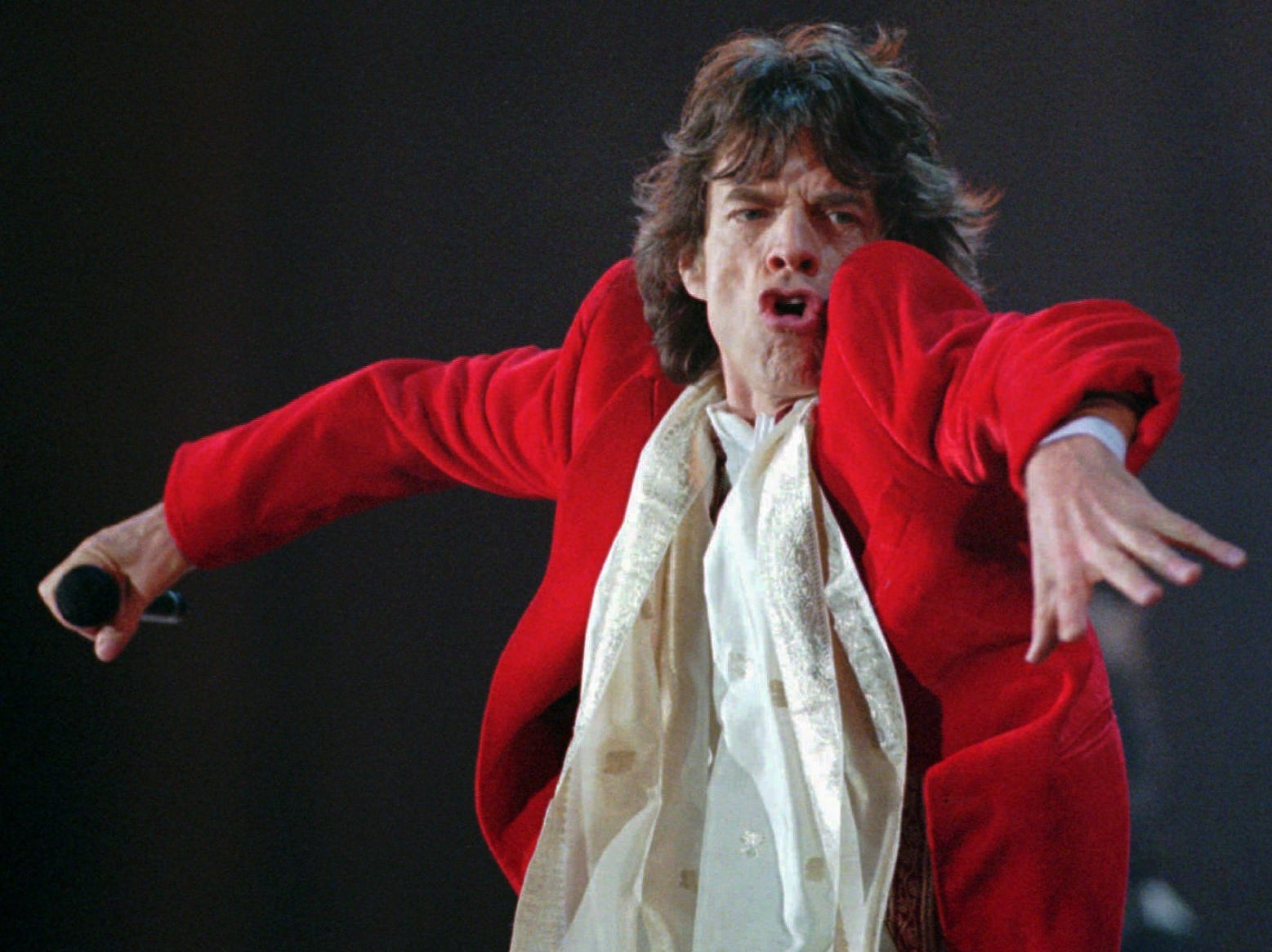 Mick Jagger performs during the Rolling Stones concert Thursday night, Oct. 16, 1997, at Giants Stadium in East Rutherford, N.J.  (AP Photo/Bill Kostroun) ORG XMIT: ERA105