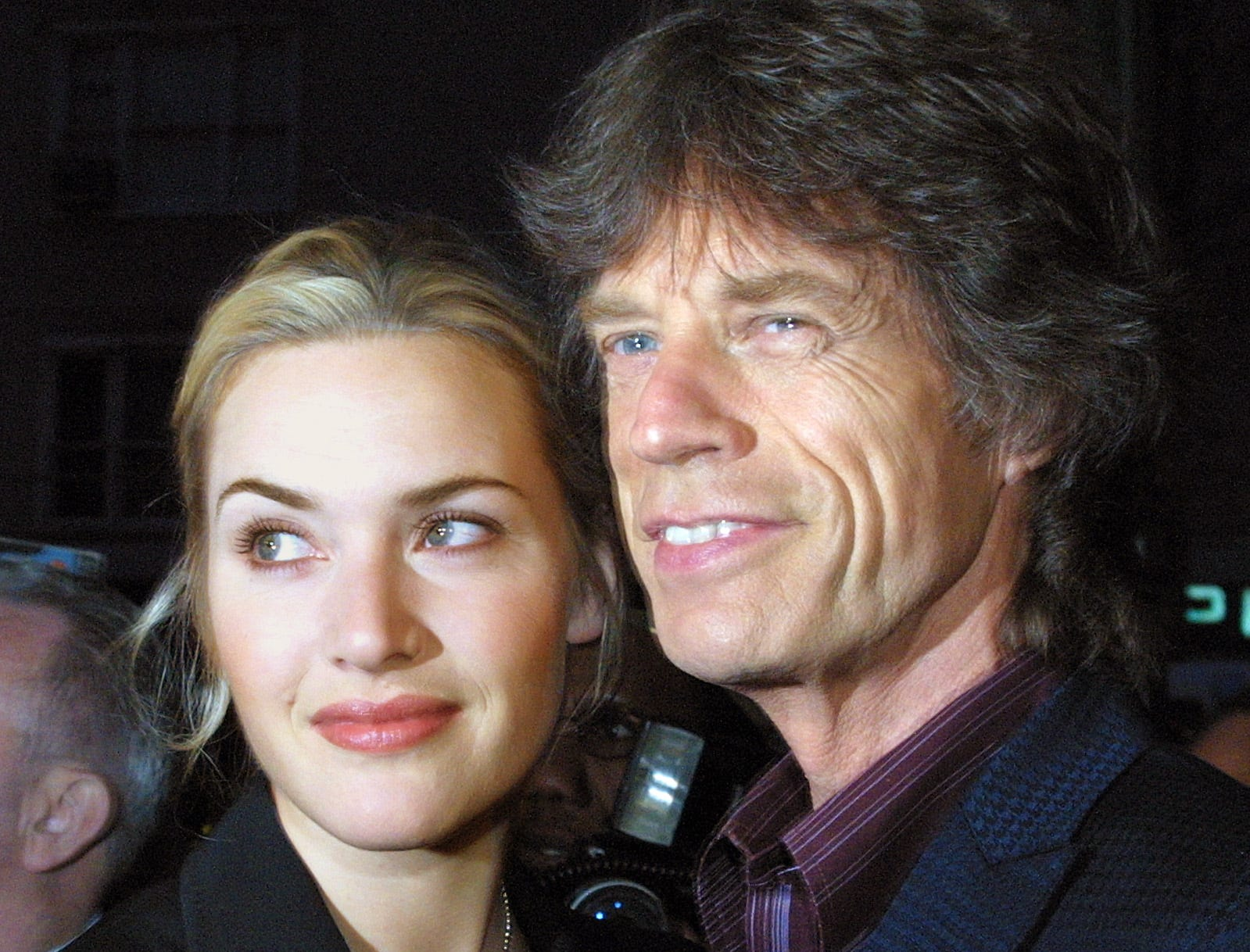 "Mick Jagger and actress Kate Winslet arrive at New York City's Beekman Theatre for the New York benefit premiere of ""Enigma,"" Thursday, April 11, 2002. Some of the proceeds from the screening will go to benefit the International Rescue Committee, which provides long term aid to refugees in 30 countries. (AP Photo/Tina Fineberg)"