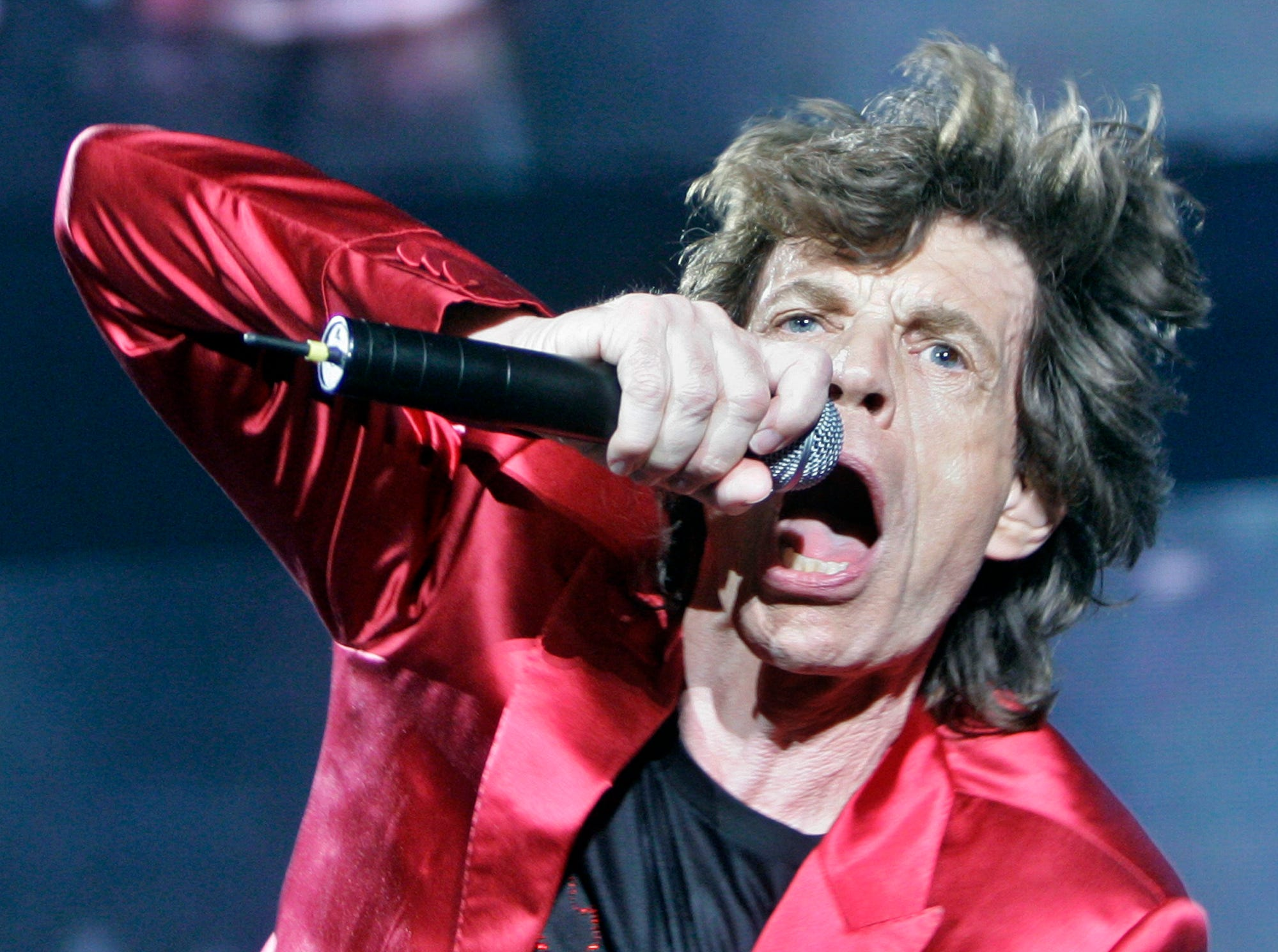 Mick Jagger performs during the concert of the Rolling Stones 'Bigger Bang' tour in Barcelona, Spain, Thursday, June 21, 2007. (AP Photo/Manu Fernandez)