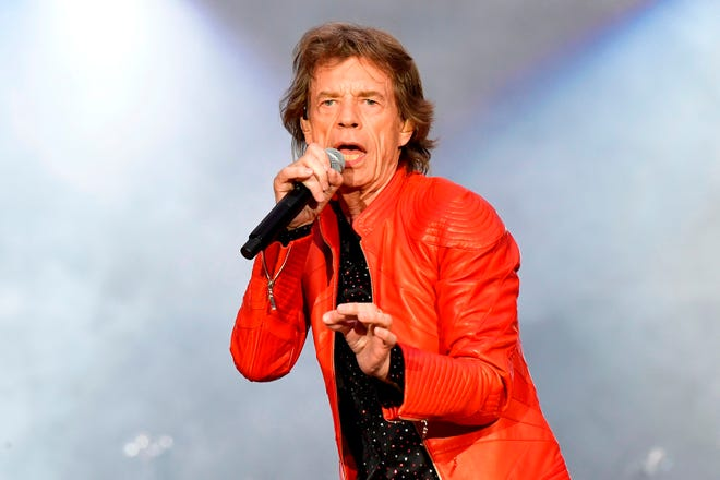 Singer of British band the Rolling Stones, Mick Jagger performs with the band during a  concert at Berlin's Olympic Stadium on June 22, 2018.