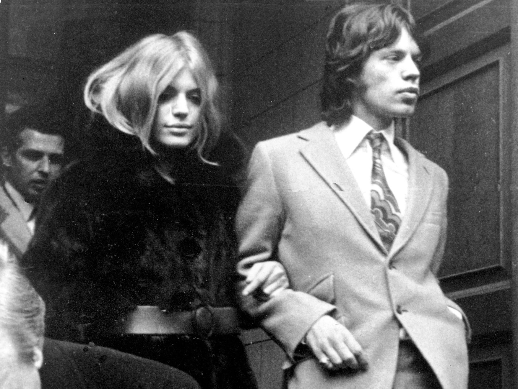 Lead singer of The Rolling Stones Mick Jagger and British pop singer Marianne Faithfull appeared in court for possession of marijuana in London, England on Dec. 18, 1969. (AP Photo/Laurence Harris)
