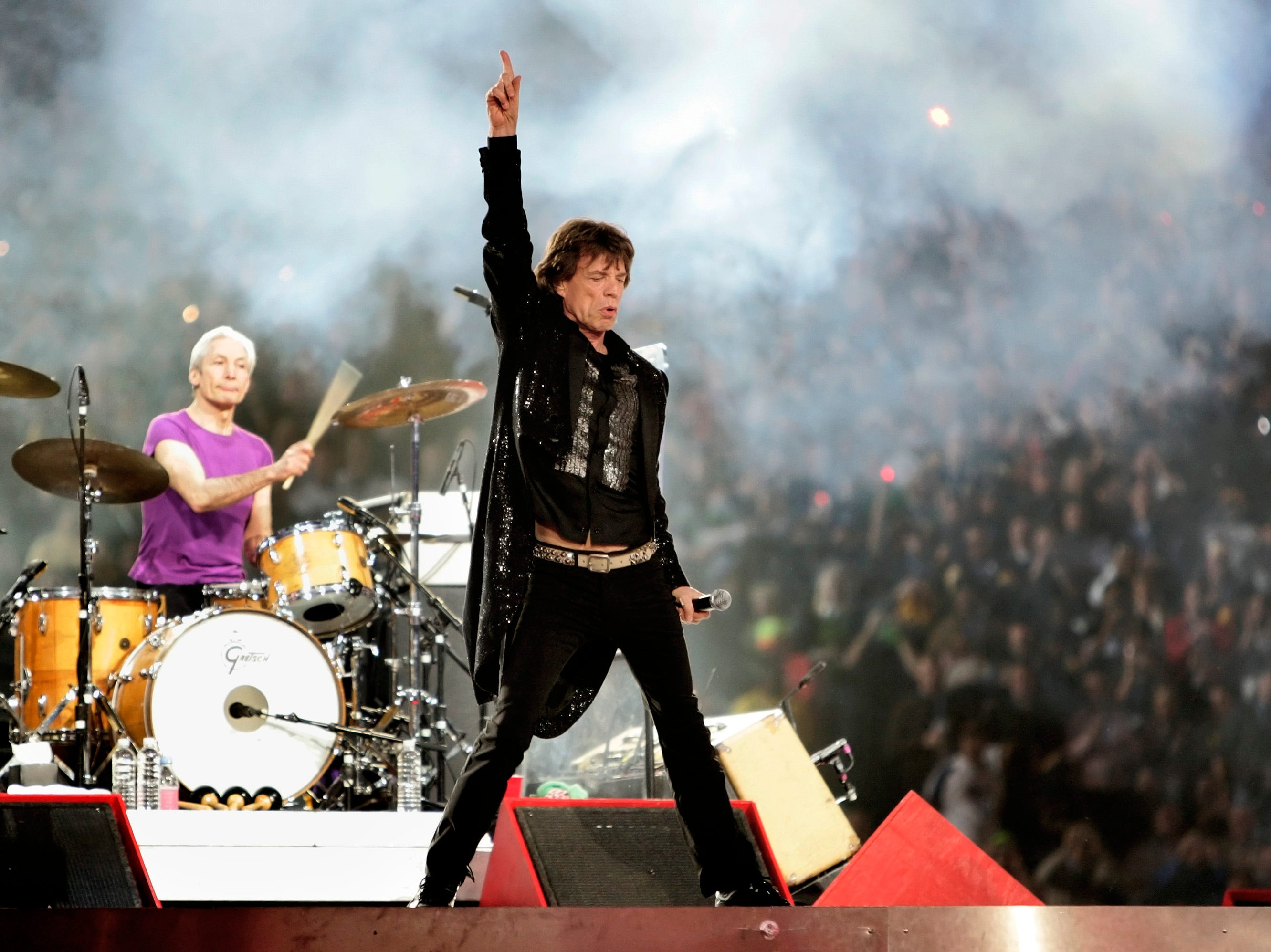 Mick Jagger performs with the Rolling Stones at halftime of the Super Bowl XL football game Sunday, Feb. 5, 2006, in Detroit. In the background is drummer Charlie Watts.  (AP Photo/David J. Phillip)