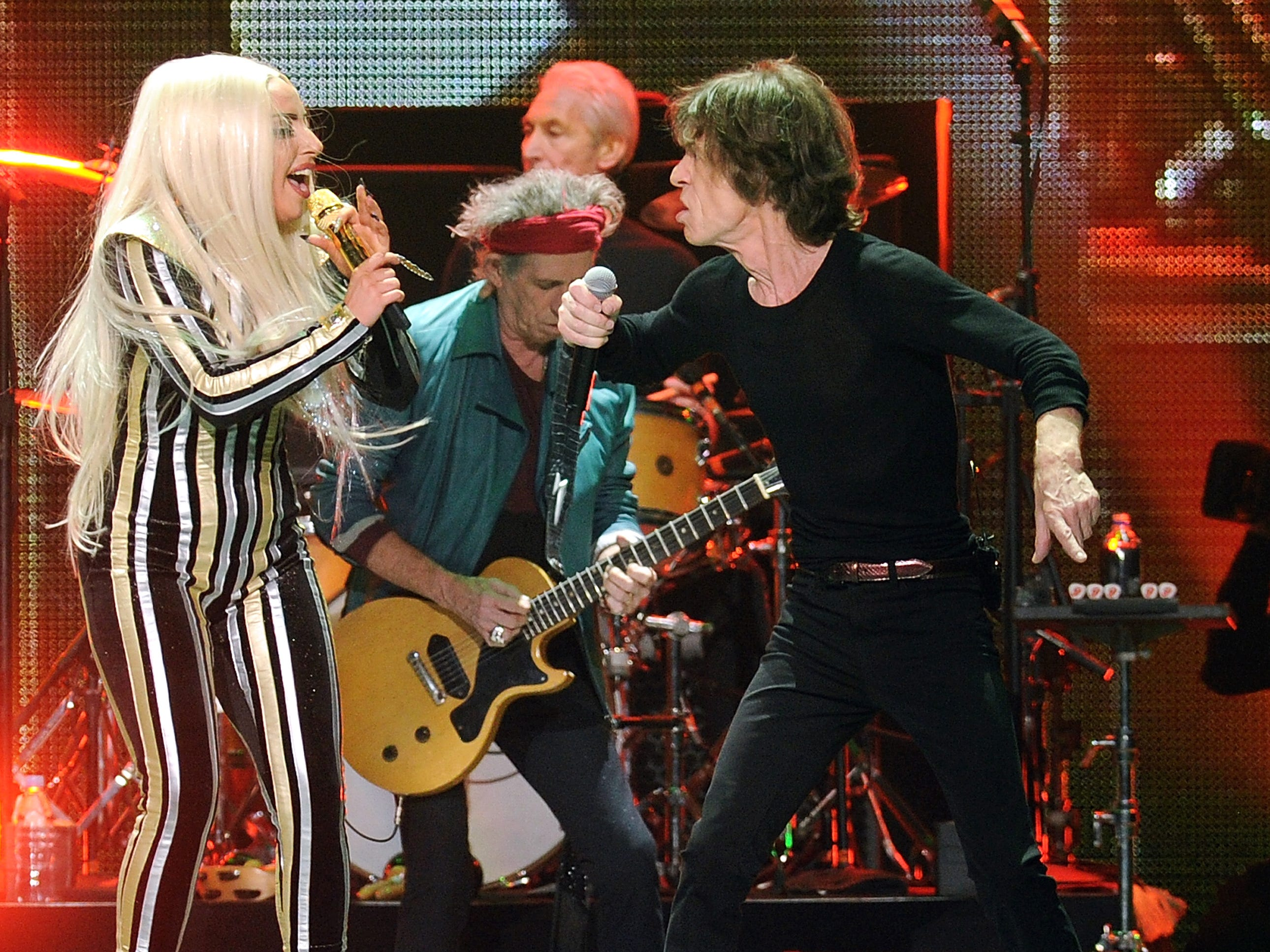 Singer Lady Gaga and Mick Jagger of The Rolling Stones perform together at the Prudential Center in Newark, NJ on Saturday, Dec. 15, 2012. (Photo by Evan Agostini/Invision/AP) ORG XMIT: NYEA106
