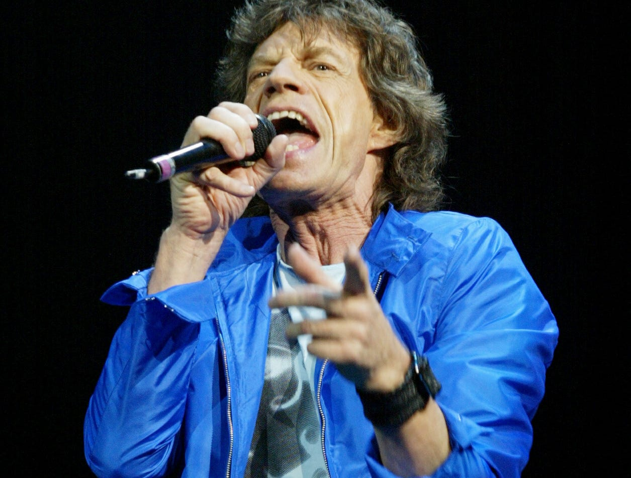 9/3/02 -- BOSTON, MA  -- ROLLLING STONES OPEN TOUR -- The Rolling Stones open their 40th Anniversary Tour at the Fleet Center in Boston Tuesday night.  Mick Jagger at the microphone. (By Eileen Blass, USA TODAY) ORG XMIT: STONESJAGGER3EB2026.JPG