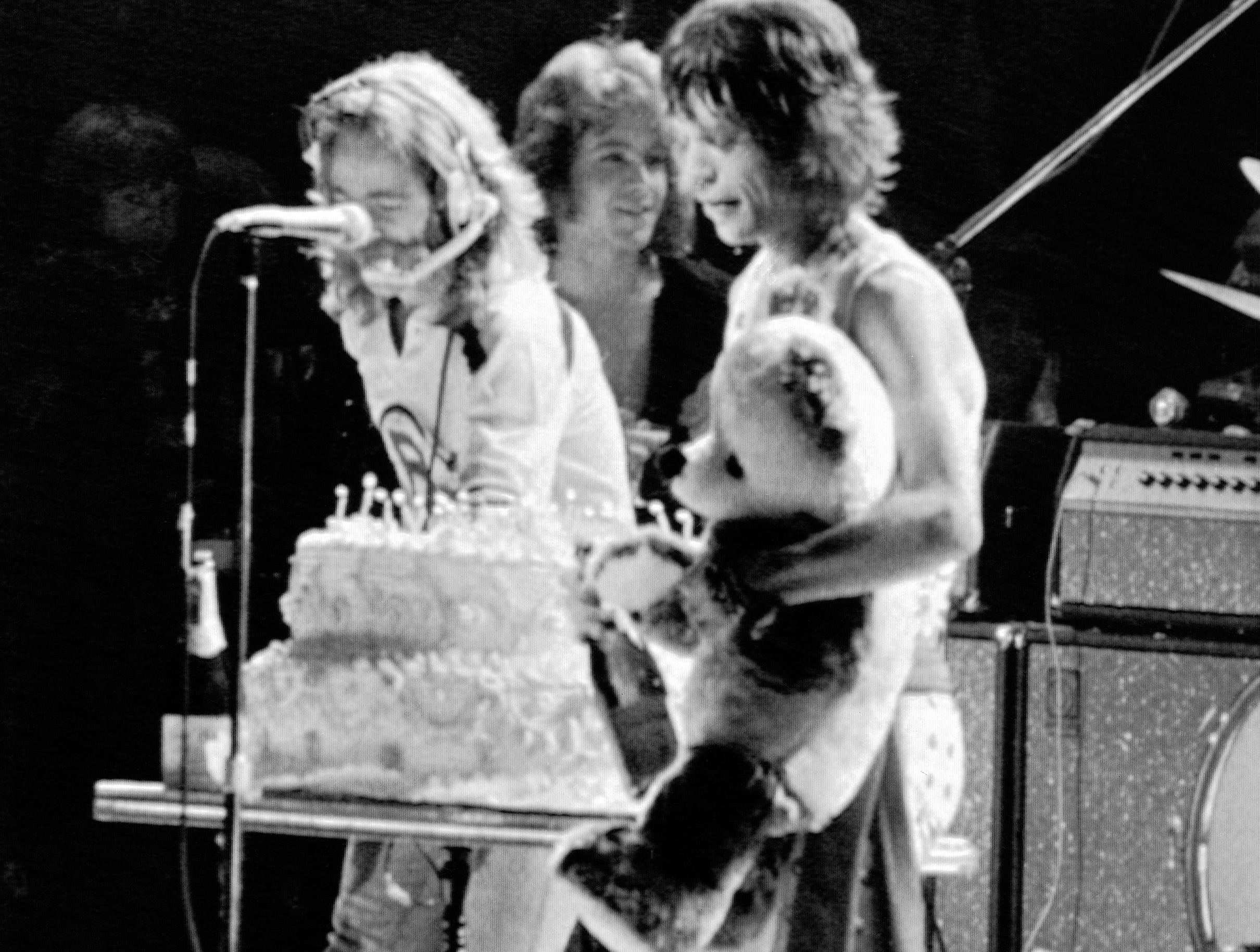 The Rolling Stones' Mick Jagger holds a big stuffed panda which was handed to him following performance at New York's Madison Square Garden on Wednesday, July 27, 1972. A birthday cake was also presented to the rock star, in honor of his 29th birthday. The Stones ended their 44-concert tour across the United States, and Canada. (AP Photo)