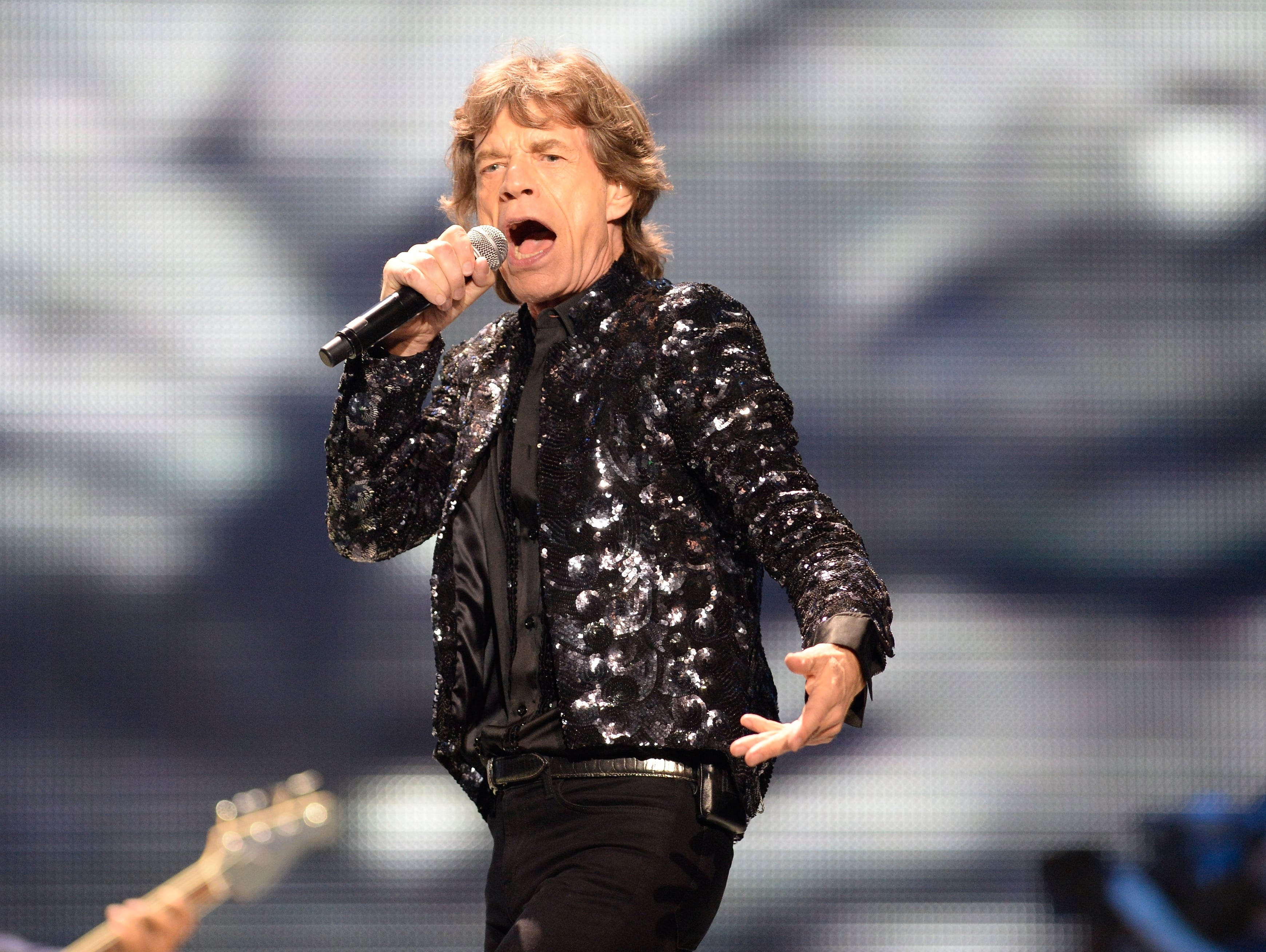 6/24/13 8:56:23 PM -- Washington, DC, U.S.A  -- Mick Jagger sings as the Rolling Stones perform the final show of the US leg of their 50th anniversary tour, and possibly their last show ever, as a group, in the US.  Photo by H. Darr Beiser, USA TODAY Staff ORG XMIT:  HB 129826 ROLLING STONES 6/24/2013 (Via OlyDrop)
