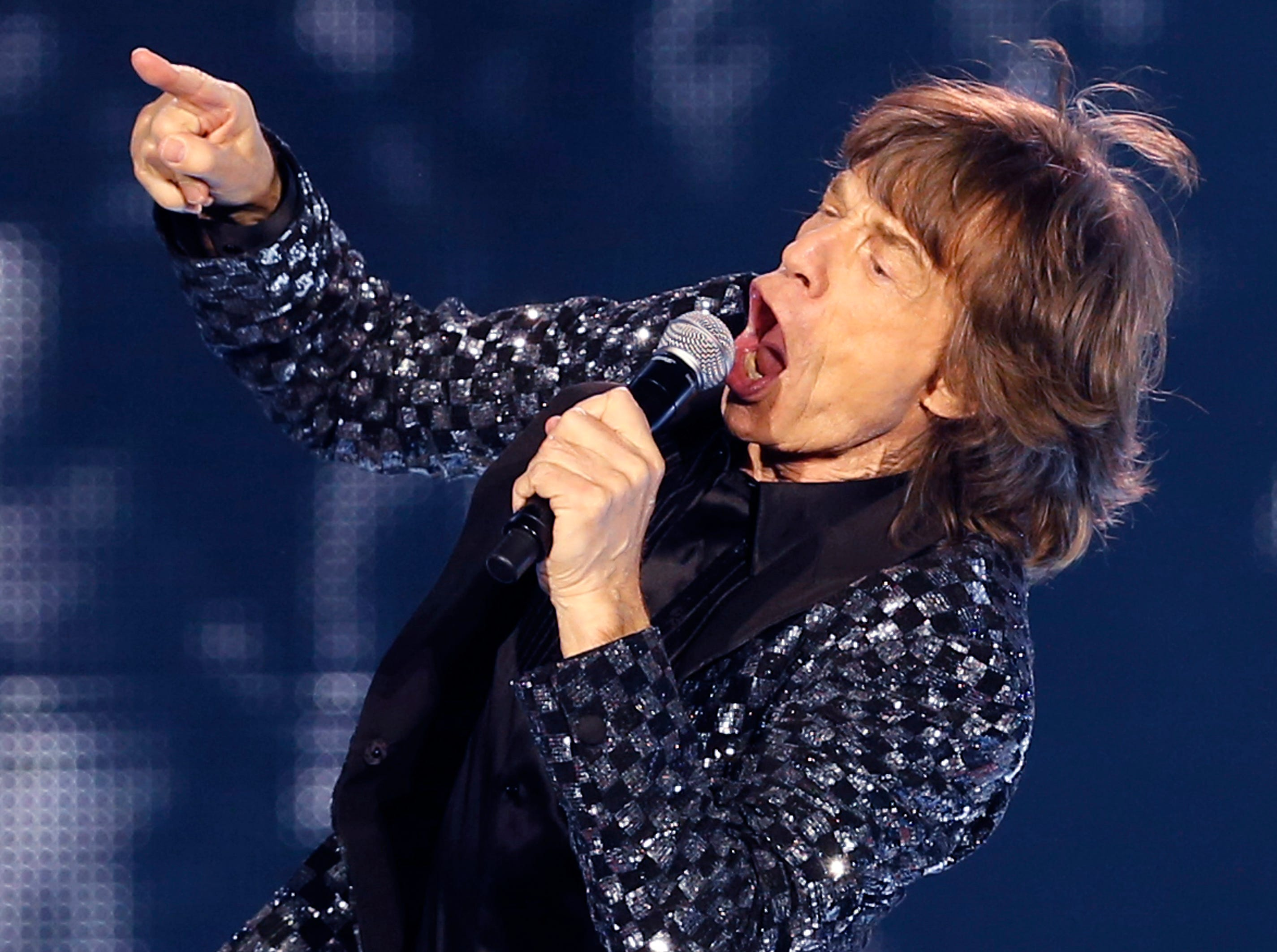 Mick Jagger of The Rolling Stones performs during their concert at Tokyo Dome in Tokyo, Wednesday, Feb. 26, 2014. (AP Photo/Shizuo Kambayashi) ORG XMIT: XKAN101