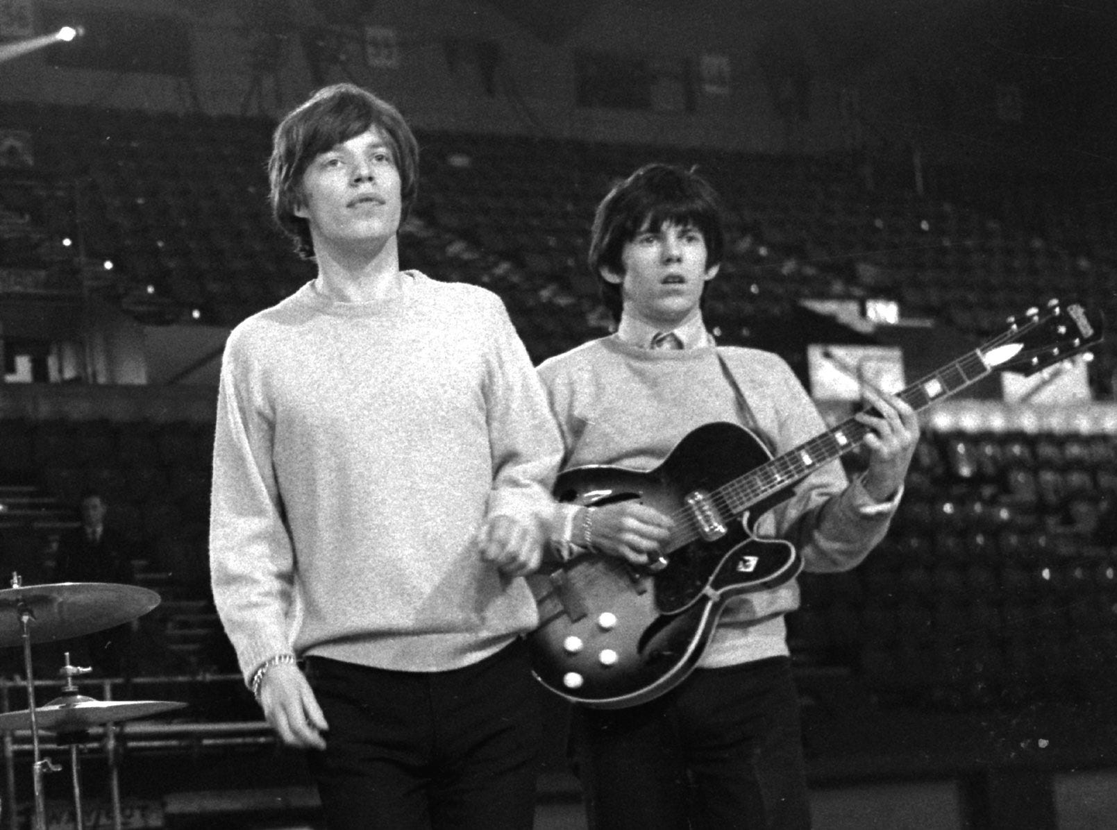 "FILE- Mike Jagger, left, and Keith Richards of British rock band ""The Rolling Stones"", rehearse in London in this April 1964 file photo. An early recording made by a friend while the two were still at school is due to be auctioned by Christie's in London on Thursday May 25 1995. The recording is expected to be sold for up to 55,000 pounds ($88,500)  (AP PHOTO/FILES)"
