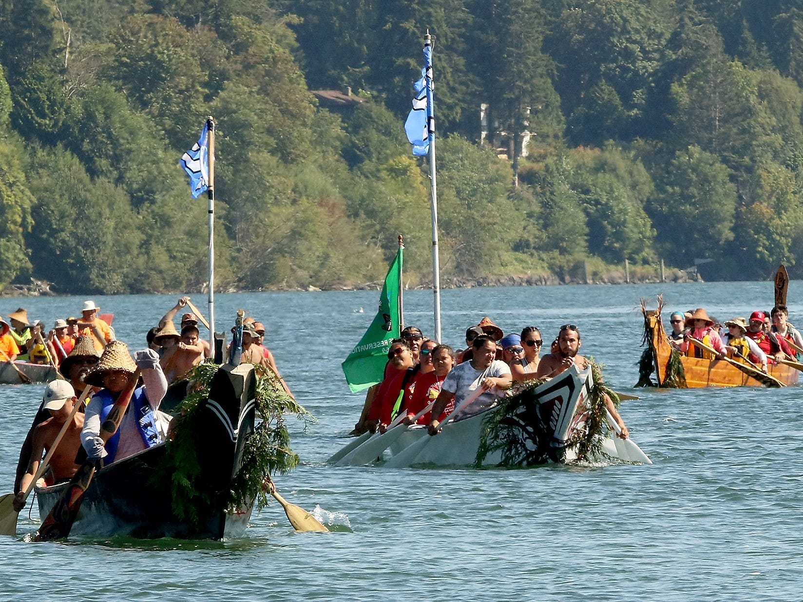 """Participants in the Tribal Canoe Journey """"Paddle to Puyallup"""" head for the shore of Point Julia on Tuesday, July 24, 2018."""