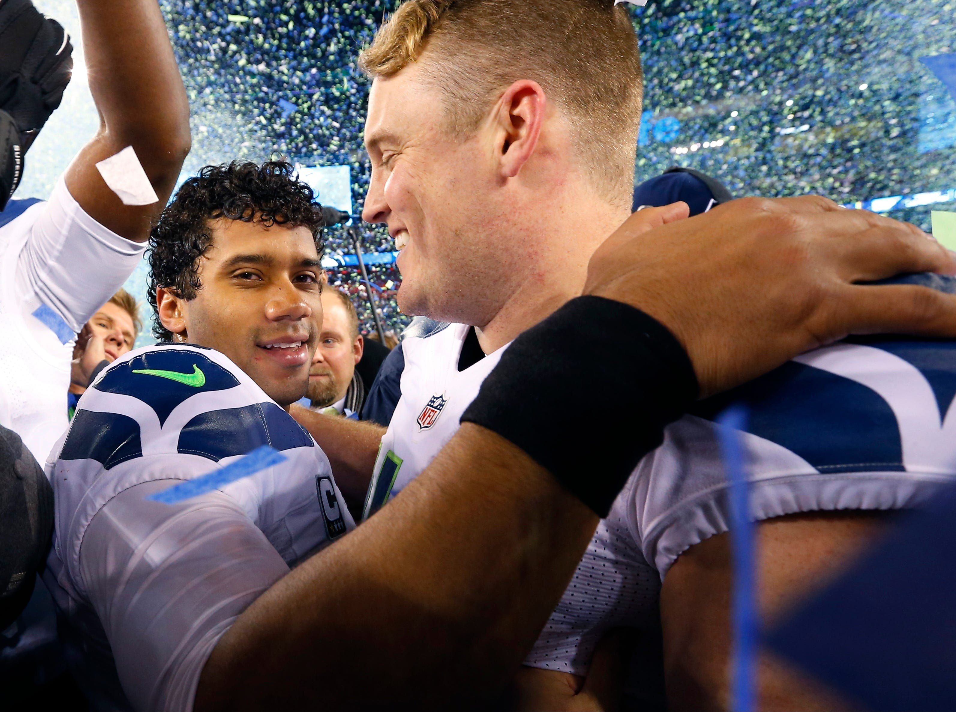Seattle Seahawks' Russell Wilson, left, celebrates with teammate Clint Gresham after the NFL Super Bowl XLVIII football game Sunday, Feb. 2, 2014, in East Rutherford, N.J. The Seahawks won 43-8. (AP Photo/Paul Sancya)