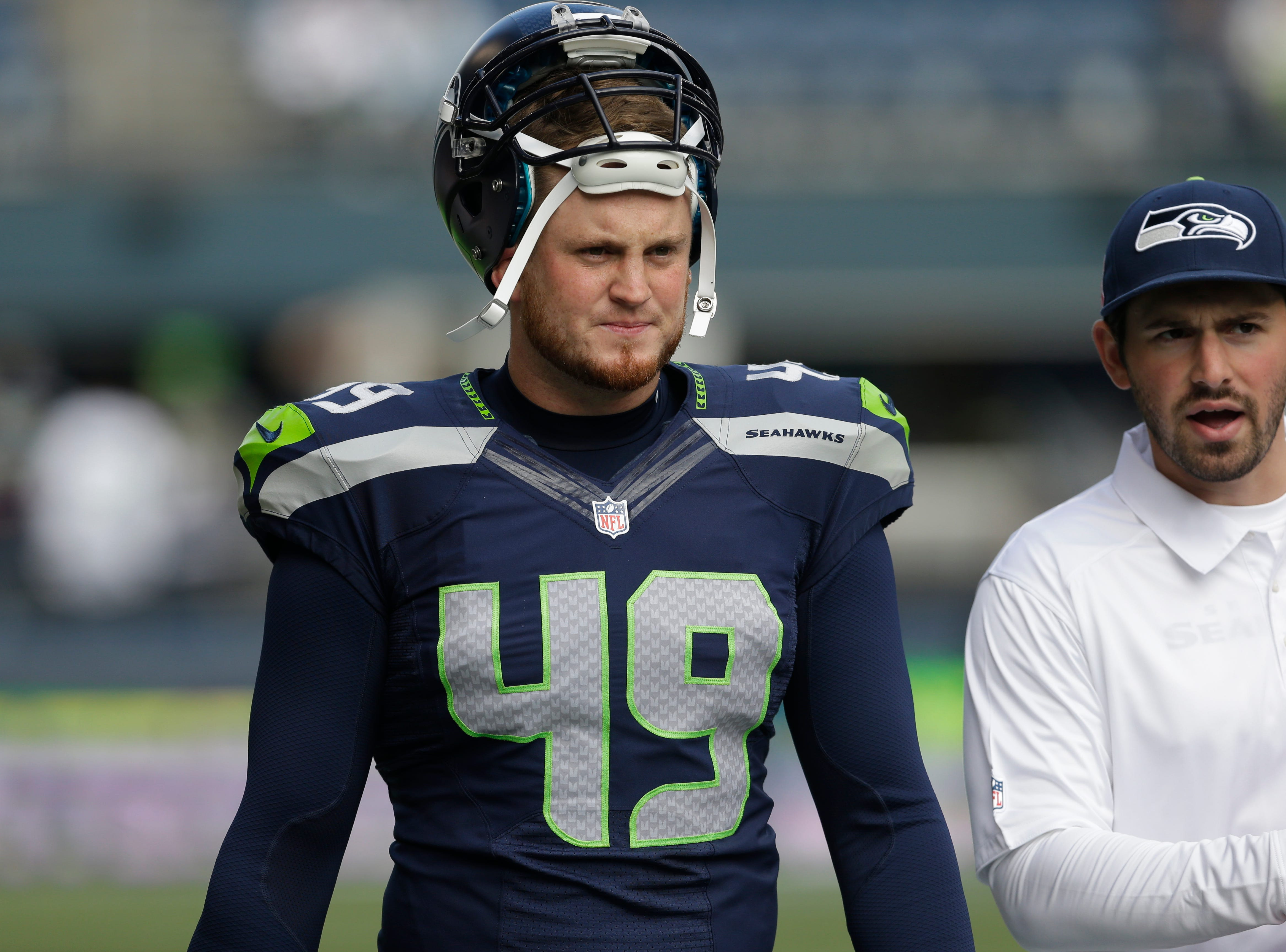Seattle Seahawks' Clint Gresham stands on the sidelines before an NFL football game agains the Tennessee Titans, Sunday, Oct. 13, 2013, in Seattle. (AP Photo/Elaine Thompson)