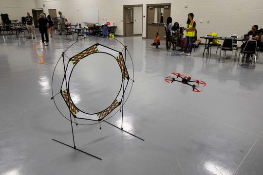 Campers at Del Mar College's Smart Girlz Summer Coding Camp fly drones though obstacles on Wednesday, July 25, 2018.
