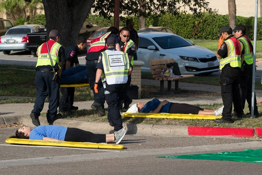 Police and firefighters treat a victim during an emergency training exercise at Texas A&M University-Kingsville on Wednesday, July 25, 2018.