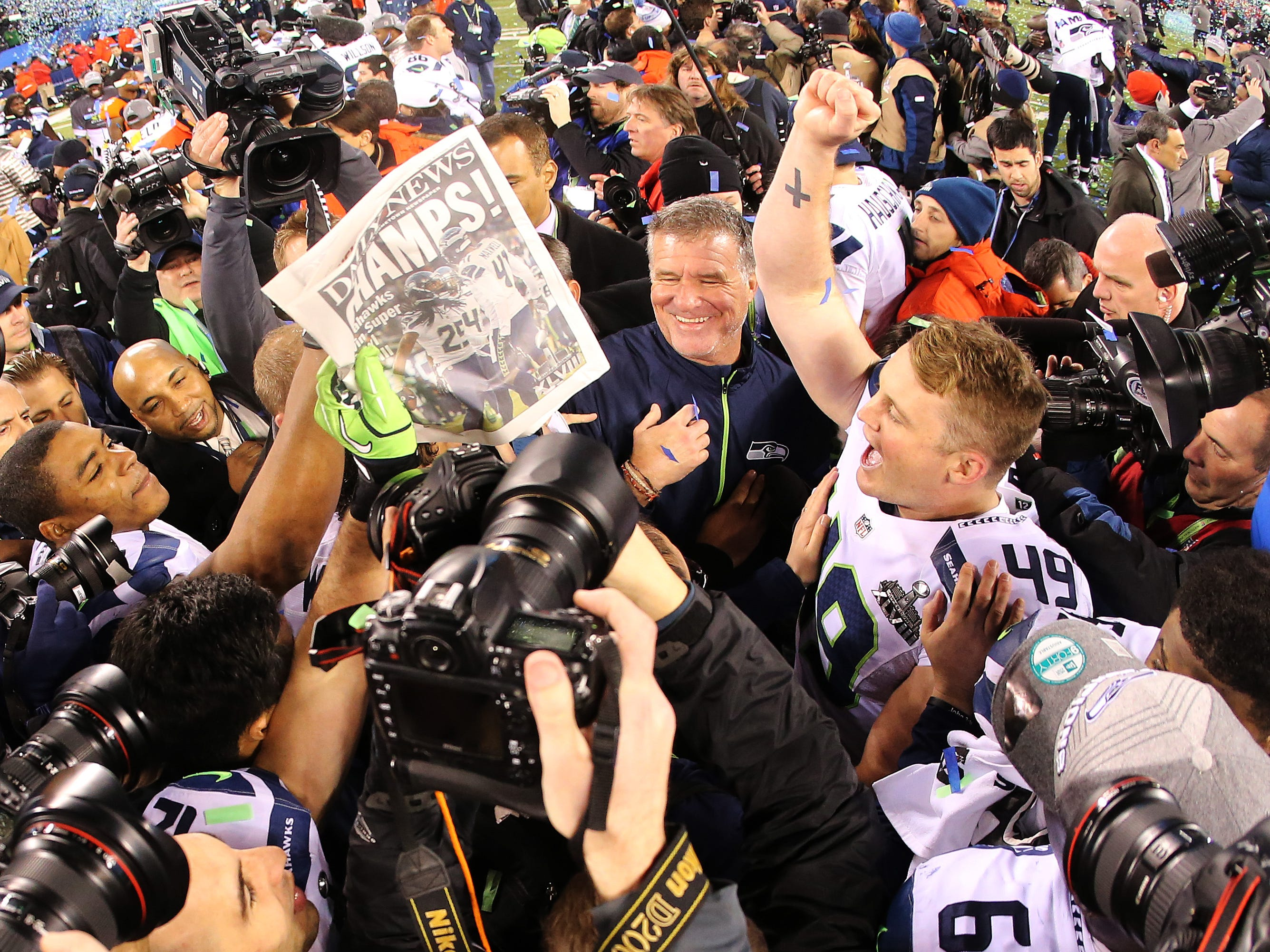 Long snapper Clint Gresham #49 of the Seattle Seahawks  celebrates with teammates on the field after winning Super Bowl XLVIII at MetLife Stadium on February 2, 2014 in East Rutherford, New Jersey. The Seahawks beat the Broncos 43-8.   (Photo by Jamie Squire/Getty Images)