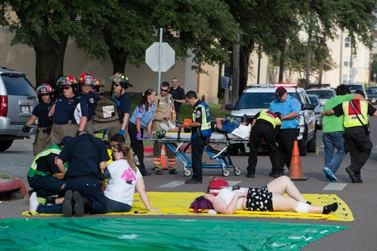 Police and firefighters treat a victims during a emergency training exercise at Texas A&M University-Kingsville on Wednesday, July 25, 2018.