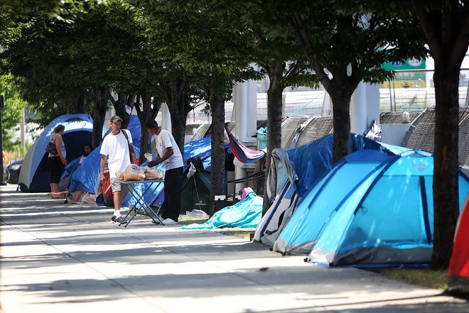 A group of homeless people have been placing their tents along Third Street, downtown.