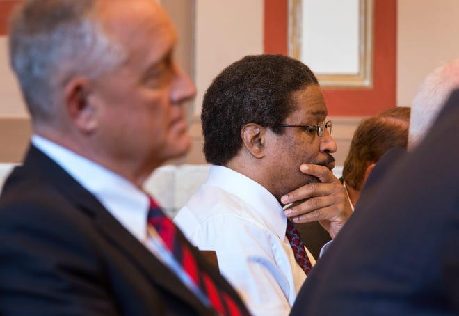 "Convicted serial killer Anthony Kirkland, 49 listens to testimony during his re-sentencing for the deaths of Casonya ""Sheree"" Crawford, 14, in 2006 and Esme Kenney, 13, in 2009. At left is Hamilton County Prosecutor Joe Deters, who will once again ask for the death penalty."