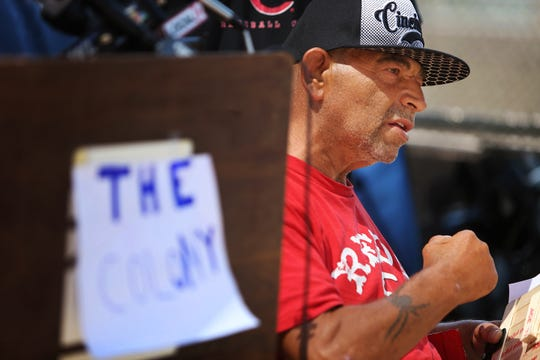 A Navy veteran named Robert, who has been homeless for two months, speaks from his wheelchair during a press conference held on Third Street, where a group of homeless people have been placing their tents. A homeless camp beneath the Interstate 71 overpass near Third Street was recently cleared out.