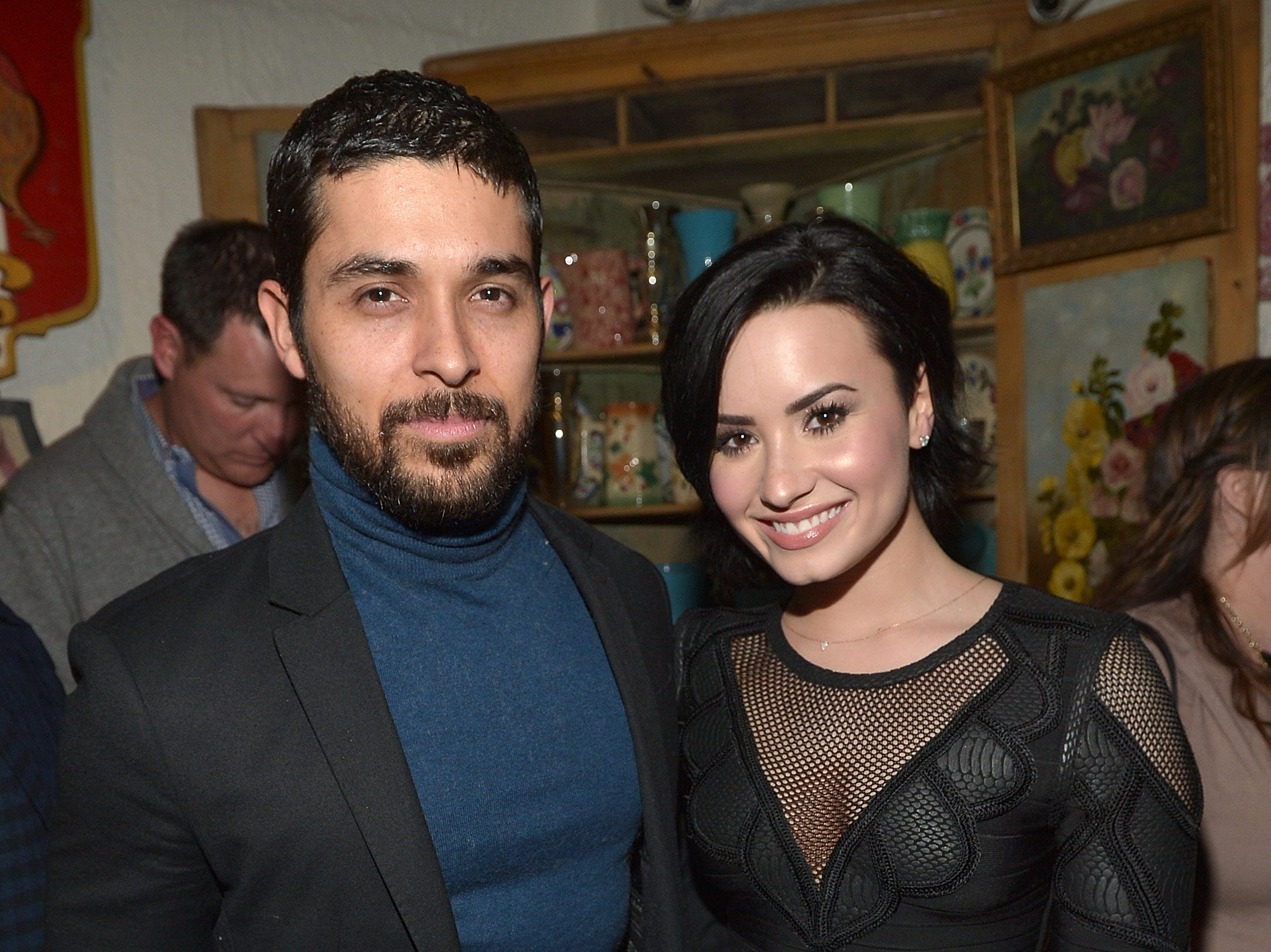 "LOS ANGELES, CA - JANUARY 20:  Wilmer Valderrama and Demi Lovato celebrate Nick Jonas' song ""Jealous"" being the #1 At Top 40 radio hit at The Ivy on January 20, 2015 in Los Angeles, United States."