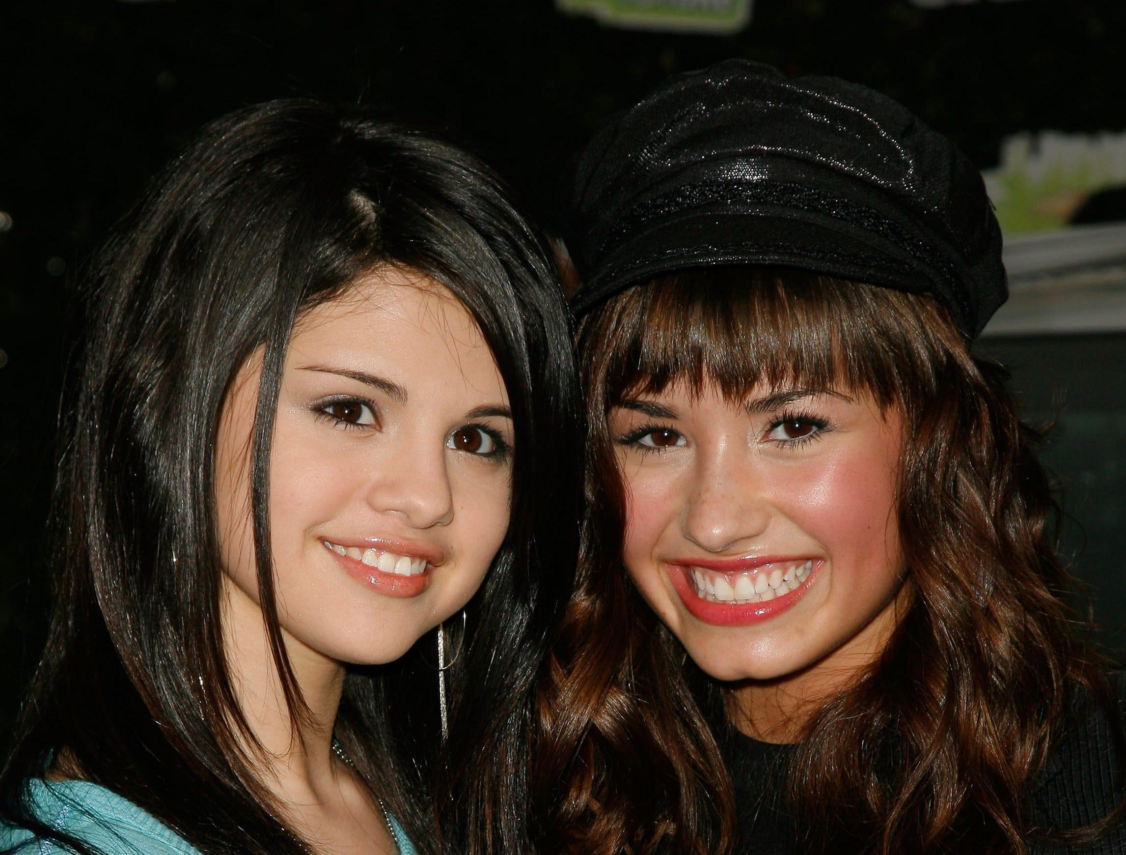 BURBANK, CA - FEBRUARY 19:  Actresses Selena Gomez and Demi Lovato arrive at Chevy Rocks The Future at the Buena Vista Lot at The Walt Disney Studios February 19, 2008 in Burbank, California.