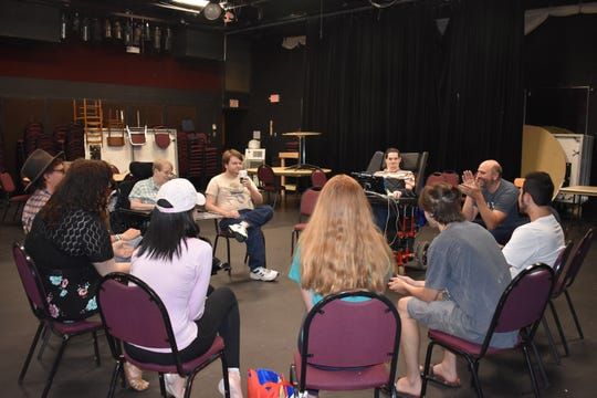 RVCC Theatre Professor Dennis Russo applauds his students' work in rehearsal of Personal Care Assistant during the College's Theatre Production class.