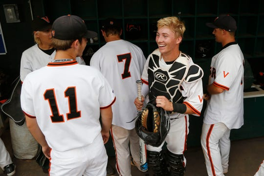 West Des Moines Valley catcher Jack Thompson (right) celebrates with his teammates Wednesday, July 25, 2018, after their quarterfinal win over Waukee at the state baseball tournament in Des Moines.