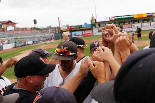 West Des Moines Valley players celebrate Wednesday, July 25, 2018, after their quarterfinal win over Waukee at the state baseball tournament in Des Moines.