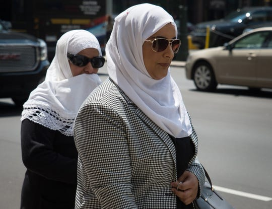 Ibraheem Izzy Musaibli's sister, right, and mother, left, leave the Theodore Levin Federal Courthouse in Detroit on July 25, 2018.