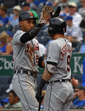 Tigers left fielder Victor Reyes celebrates with teammate Nicholas Castellanos after scoring a run during the sixth inning on Wednesday, July 25, 2018, in Kansas City, Mo.