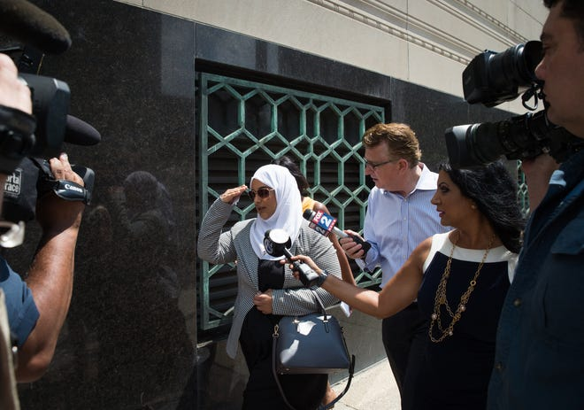 Ibraheem Izzy Musaibli's sister leaves the Theodore Levin Federal Courthouse in Detroit on July 25, 2018.