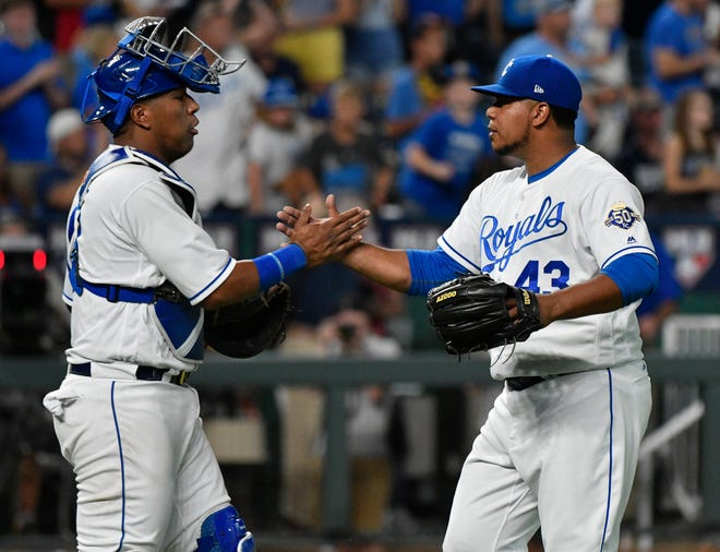 Relief pitcher Wily Peralta, right, with catcher Salvador Perez after a Kansas City Royals win over the Tigers.