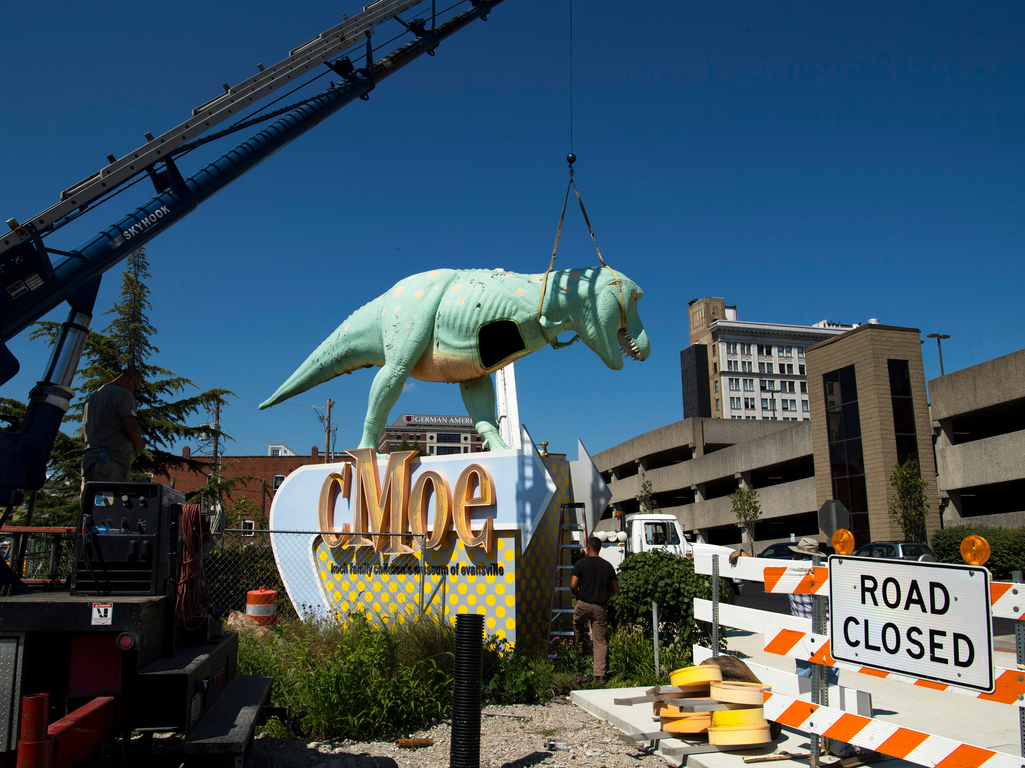 Millie spends her last minutes perched across from the Koch Family Children's Museum of Evansville Wednesday morning. She was later disassembled and transported to Custom Sign in Newburgh, Ind., for restoration. The new construction at her corner of Locust and Fifth streets is forcing her to find a new place to call home.
