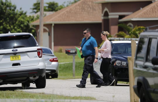 Members of the Cape Coral Police Department investigate the scene of a home near Northwest Fifth Street and Northwest 21st Ave. that has been secured.