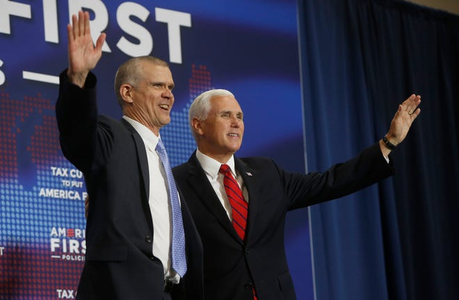 Vice President Mike Pence, right, and Republican U.S. Senate candidate Matt Rosendale wave to the crowd during the America First Policies event at MetraPark's Montana Pavilion Wednesday, July 25, 2018 in Billings, Mont. Pence touted the Trump administration's accomplishments Wednesday and called Democratic U.S. Sen. Jon Tester an obstructionist while supporting his challenger Matt Rosendale. (Bethany Baker/The Billings Gazette via AP)