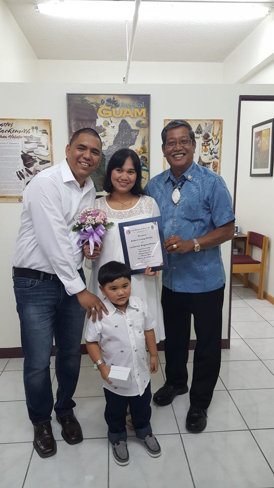 Robert Perlas and Catherine Riano were wed July 23 by Sen. Joe S. San Agustin at his office in Tamuning surrounded by family and friends. From left: Robert Perlas, ringbearer Paul Nickolas Riano Perlas, Riano and San Agustin.