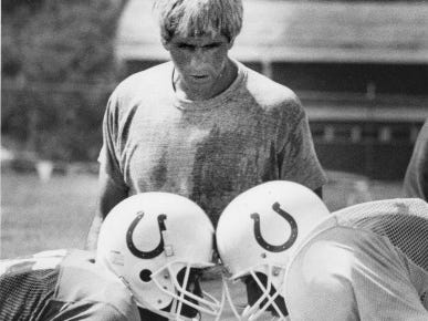 Defensive line coach John Marshall keeps a close eye on IsaacWilliams (left) and John Robertson (right) during a line drill at Colts training camp in 1986.