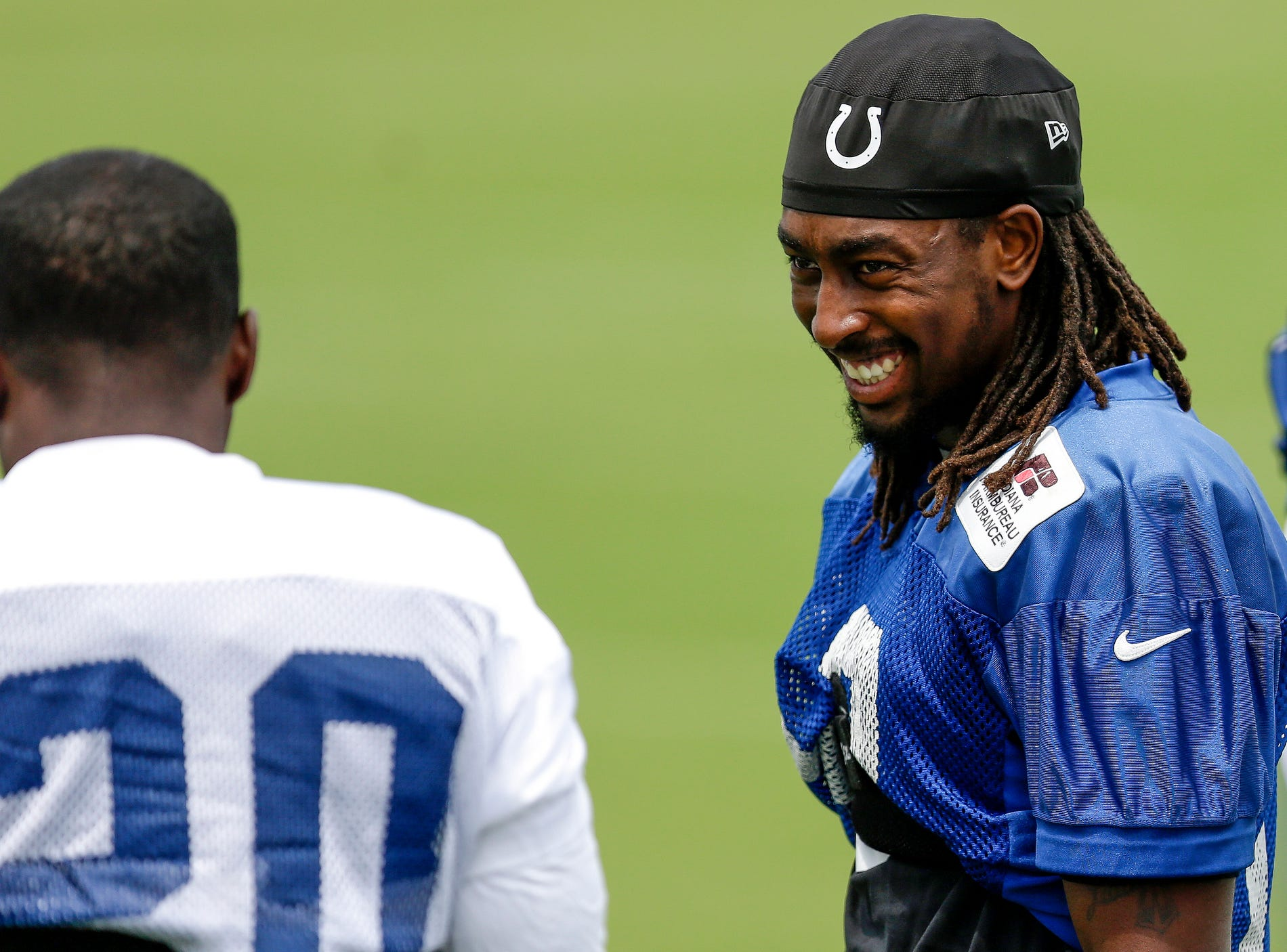 Indianapolis Colts wide receiver T.Y. Hilton (13) laughs with teammate corner back Darius Butler (20) during the Indianapolis Colts NFL training camp at Anderson University on July 28, 2016.