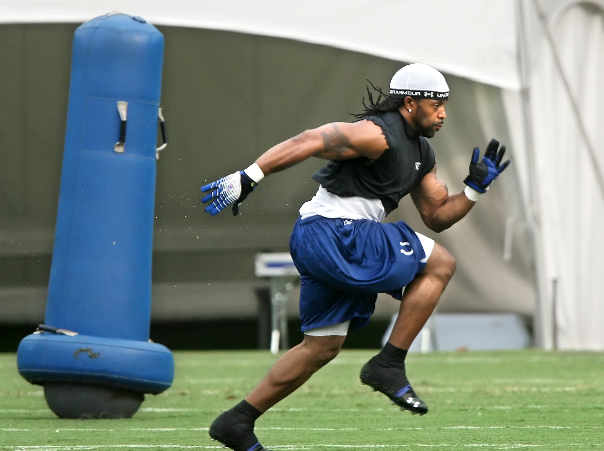 Colts defensive back Bob Sanders runs sprints as he conditions by himself without dressing during practice at Rose Hulman Institute of Technology on Wednesday, August 15, 2007.