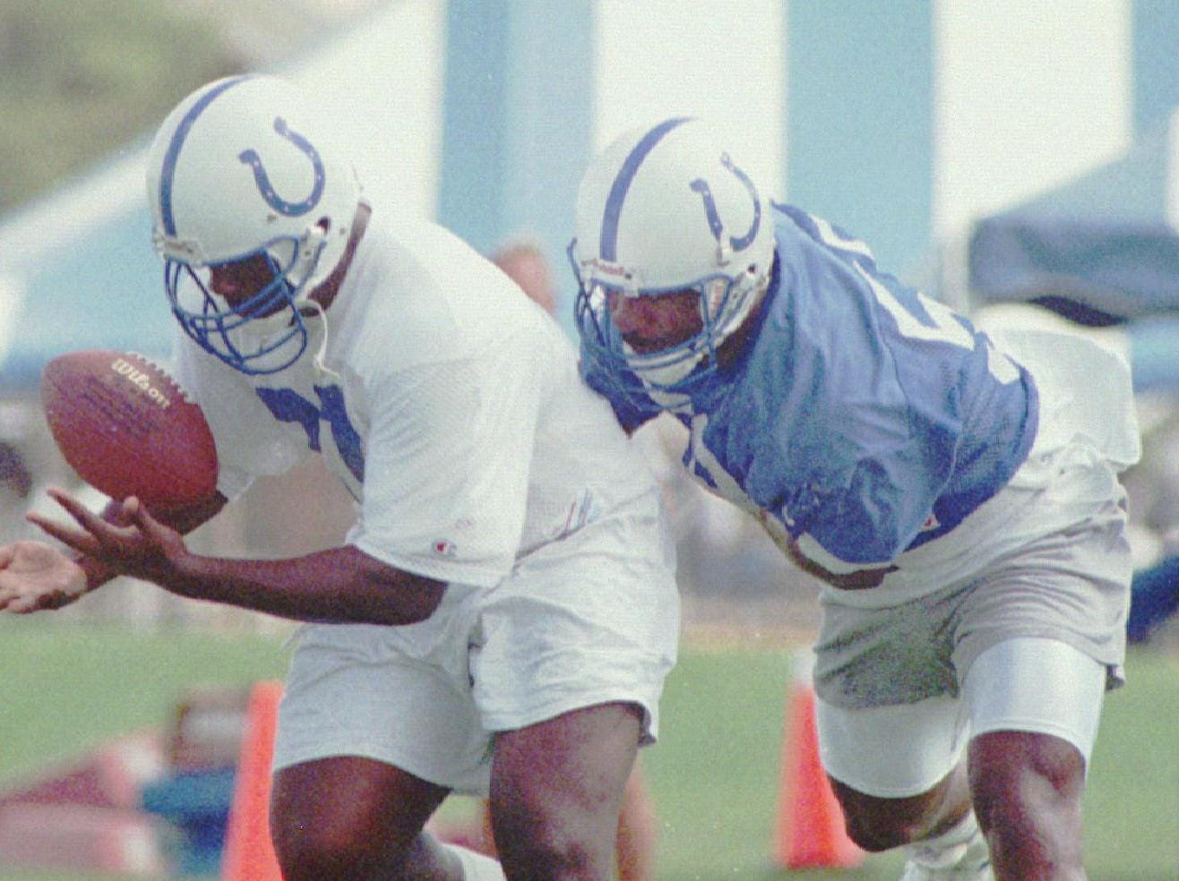 Indianapolis Colts' Quentin Coryatt, right, tries to stay with Lamont Warren during passing drill Monday, July 17, 1995, at the Colts' training camp in Anderson, Ind.