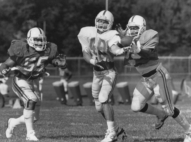Veteran Barry Kraus #55 helps Ricky Chatman #53 knock a pass loose from receiver Russell Davis #49 during 1986 Colts training camp.