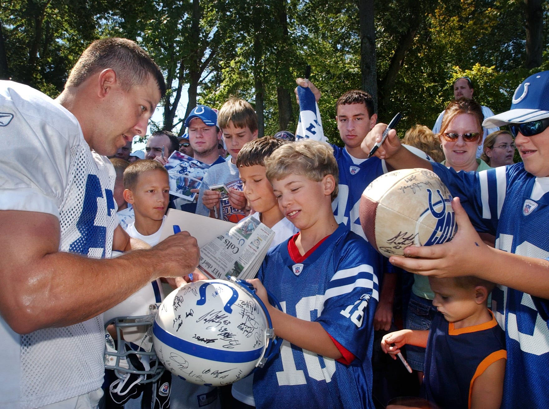 Indianapolis Colts wide receiver Brandon Stokley signs an autograph for Kent Kraus, 11, Greenwood, after the morning workout at the Colts' first training camp at Rose-Hulman Institute of Technology on Thursday, July 28, 2005.