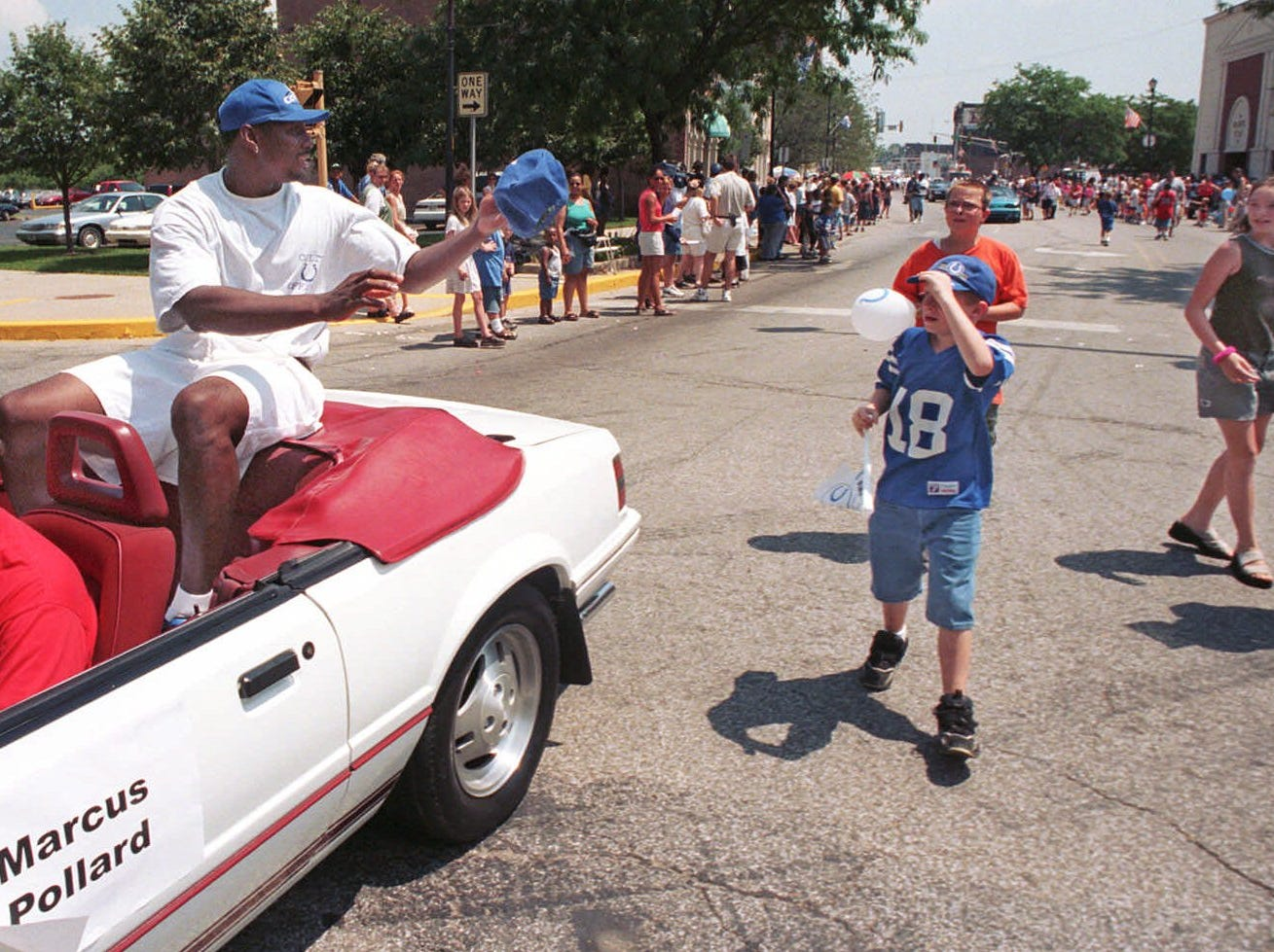 Indianapolis Colts Marcus Pollard tight end, returns a cap he autographed for a fan during the Colts welcome parade through downtown Terre Haute, Ind., Thursday, July 22, 1999. The Colts moved their summer training camp to the Rose-Hulman Institute of Technology campus in Terre Haute this year.