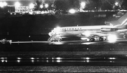 A hijacked Northwest Airlines jetliner 727 sits on a runway for refueling at Tacoma International Airport, Nov. 25, 1971, Seattle, Washington. (AP Photo)
