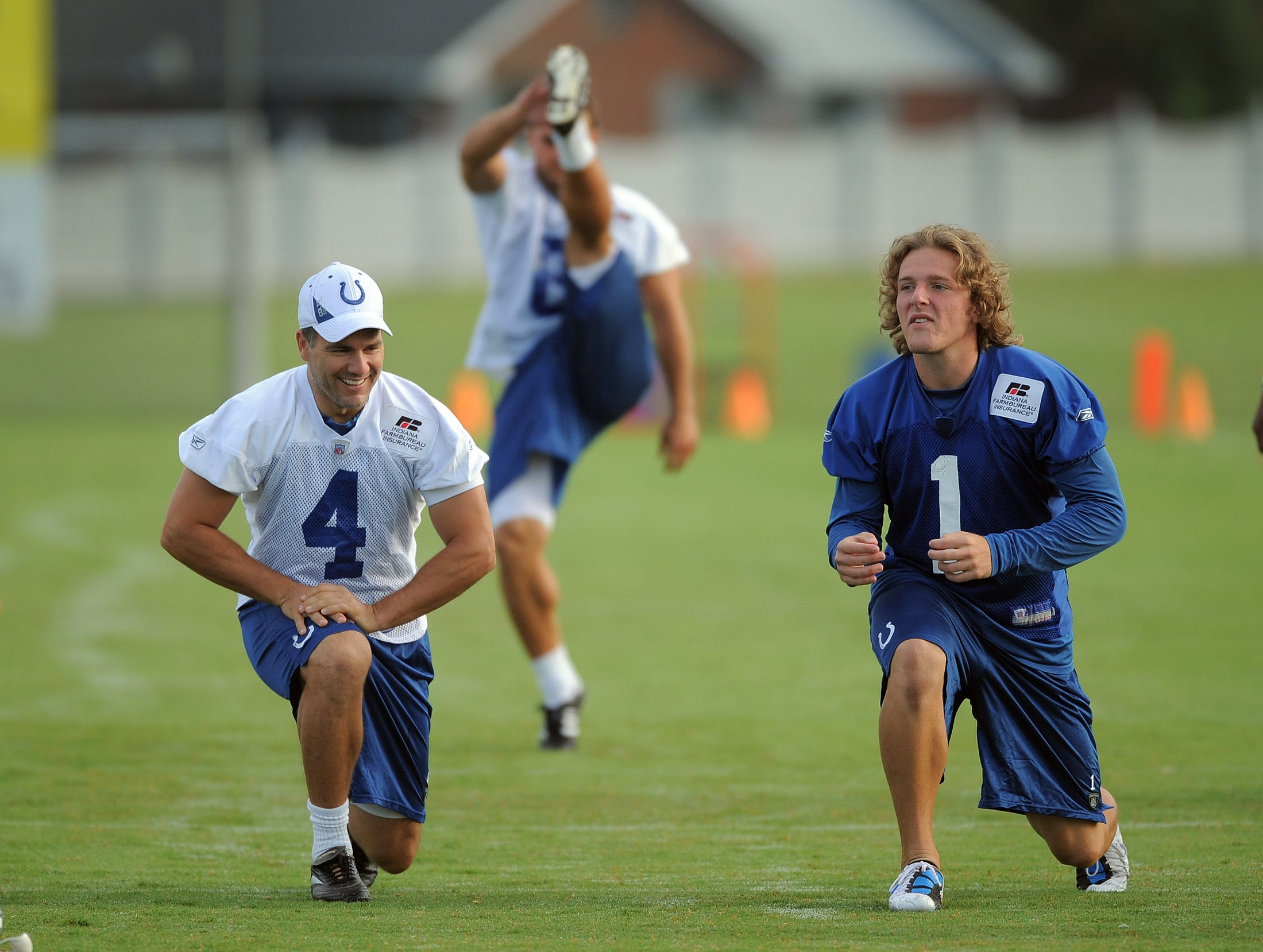 Kicker Adam Vinattieri, left, and punter Pat McAfee, right, stretch out before practice Tuesday, August 17, 2010, morning at Anderson Univeristy in Anderson IN.
