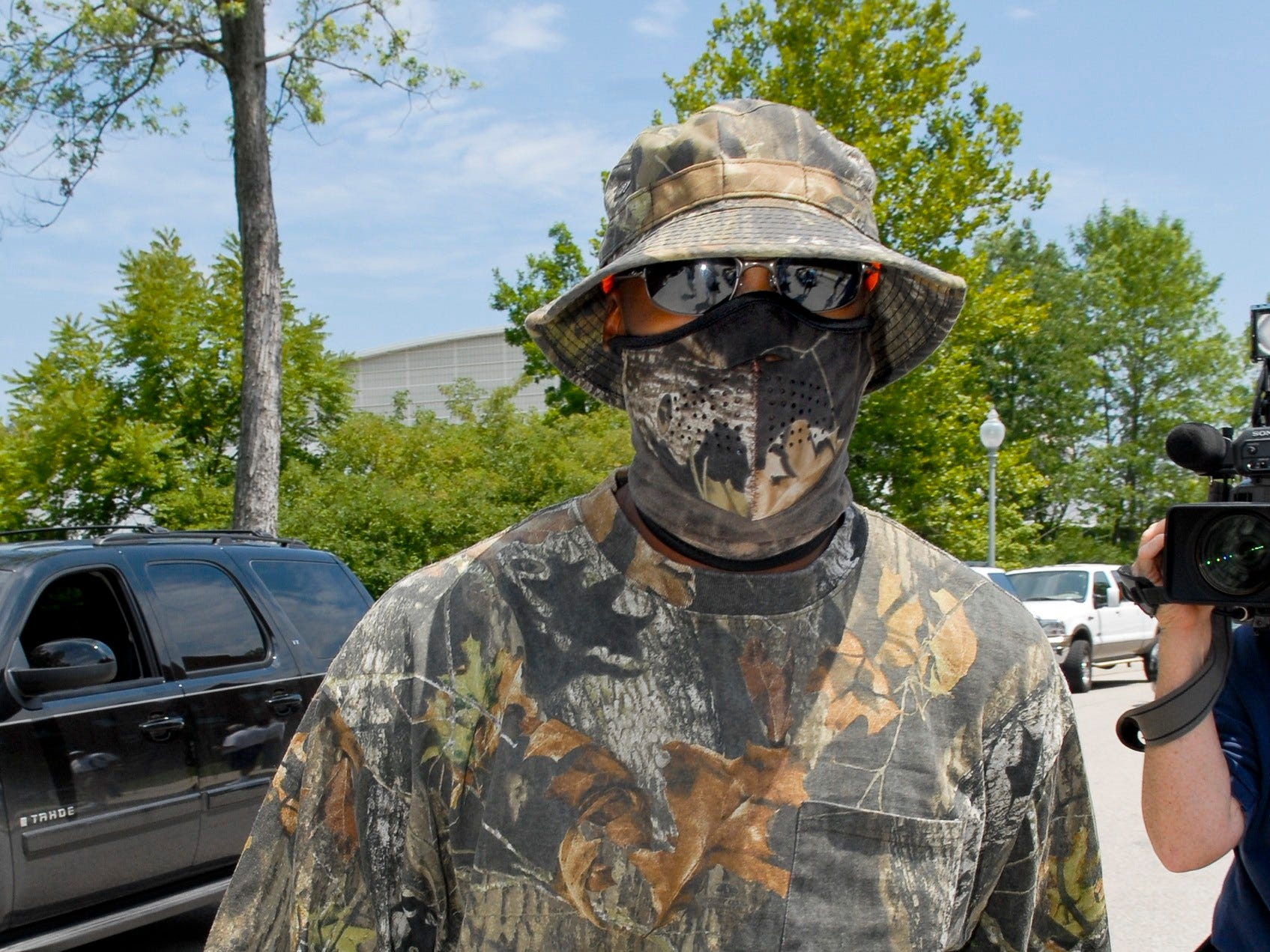 Wide receiver Reggie Wayne, dressed in full hunting camouflage, heads to the check-in area at the Indianapolis Colts football training camp in Terre Haute, Ind. on Sunday, July 29, 2007.