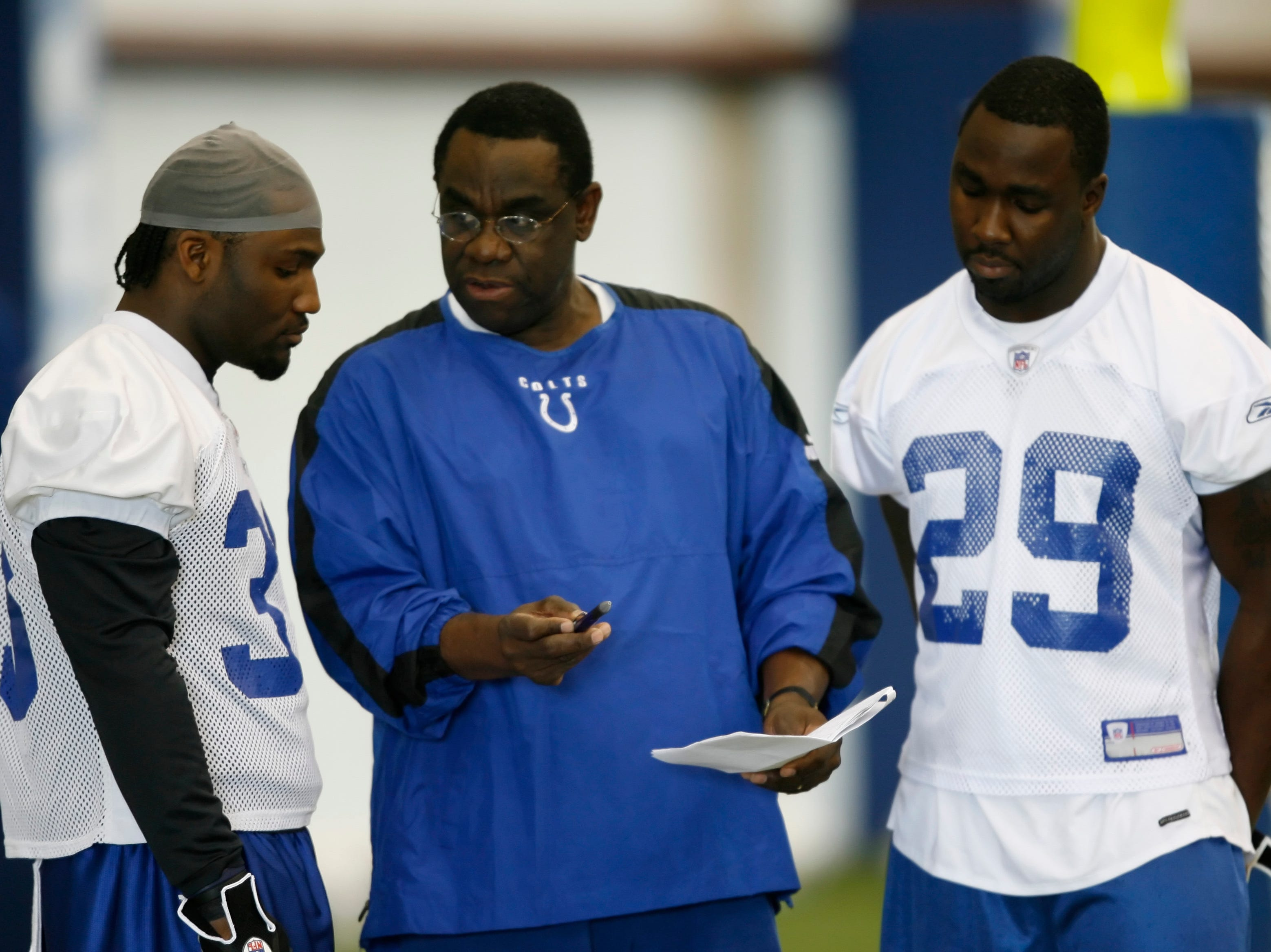 Dominic Rhodes (left), and fellow Colts running back Joseph Addai chat with Gene Huey, running backs coach.  Colts Mini Camp at the Colts Complex, Indianapolis, IN, May 19, 2006.