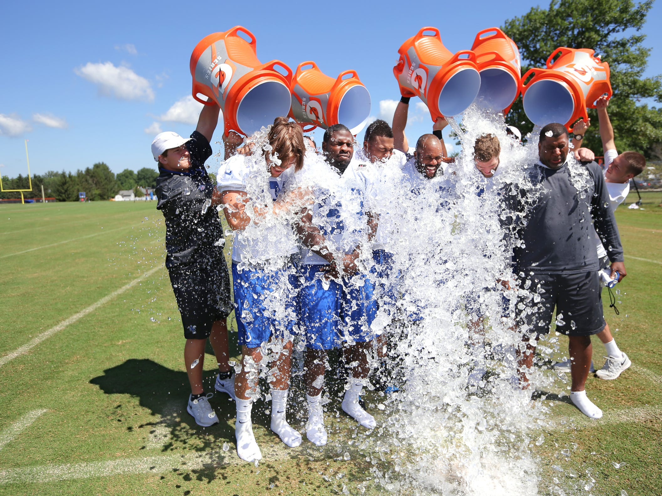The Indianapolis Colts tight ends (from left) Coby Fleener, Dwayne Allen, Weslye Saunders, Erik Swoope and Jack Doyle have buckets of ice water poured over them as they took the ALS Ice Bucket Challenge after the last day of Colts training camp at Anderson University on Wednesday, August 13, 2014.